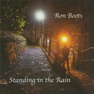 ron-boots-standing-in-the-rain